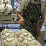 Bread making classes with Damian scoring bread loaves